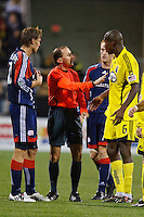 25 OCTOBER 2009:  Edgaras Jankauskas of the New England Revolution (10), Referee Kevin Stott,  Jeff Larentowicz of the New England Revolution (13) and Andy Iro of the Columbus Crew (7) during the New England Revolution at Columbus Crew MLS game in Columbus, Ohio on October 25, 2009.
