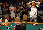 Stig Top-Rasmussen agonizes over making a call of Reagan Silber.  He folded.