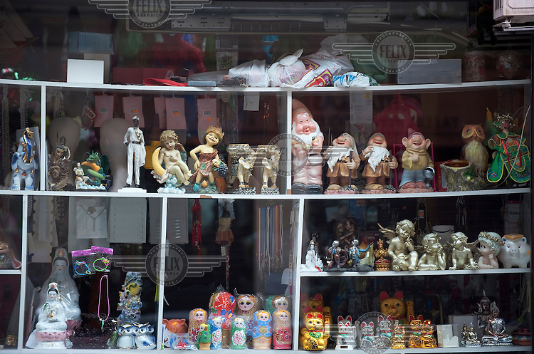 Cheap goods in the window of a Chinese owned shop in downtown Madrid.  Spain is becoming a major entreport for Chinese products and is seen by many Chinese businessmen as a gateway to the rest of Europe.