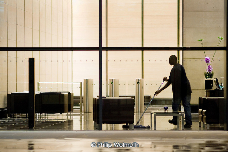Cleaner on a night shift in offices in the City of London.