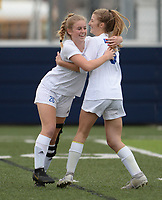 Rogers' Wesley Jackson (left) celebrates Tuesday, April 27, 2021, with Kendall Green after Green scored a goal during the first half of play against Springdale Har-Ber at Wildcat Stadium in Springdale. Visit nwaonline.com/210428Daily/ for today's photo gallery. <br /> (NWA Democrat-Gazette/Andy Shupe)