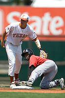 Second baseman Jamodrick McGruder #2 of the Texas Tech Red Raiders holds onto second base against the Texas Longhorns on April 17, 2011 at UFCU Disch-Falk Field in Austin, Texas. (Photo by Andrew Woolley / Four Seam Images)