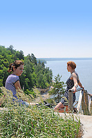 "Sad girls near the drop-and-check descent to Zhiguli reservoir in Russian National Park ""Samarskaya Luka"""