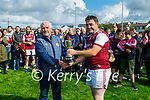 Causeway captain Shane Sheehan accepts the  Junior Hurling Championship Cup from Ger Mc Carthy of the Kerry County Committee after defeating Dr Crokes in the final