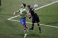 COLUMBUS, OH - DECEMBER 12: Will Bruin #17 of the Seattle Sounders FC and Josh Williams #3 of the Columbus Crew challenge for a header during a game between Seattle Sounders FC and Columbus Crew at MAPFRE Stadium on December 12, 2020 in Columbus, Ohio.