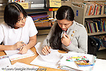 Education High School public two female students working together