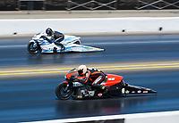 Jul 28, 2019; Sonoma, CA, USA; NHRA pro stock motorcycle rider Andrew Hines (near) alongside Jerry Savoie during the Sonoma Nationals at Sonoma Raceway. Mandatory Credit: Mark J. Rebilas-USA TODAY Sports