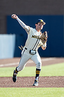 Michigan Wolverines third baseman Christian Molfetta (14) makes a throw to first base against the Michigan State Spartans on March 21, 2021 in NCAA baseball action at Ray Fisher Stadium in Ann Arbor, Michigan. Michigan scored 8 runs in the bottom of the ninth inning to defeat the Spartans 8-7. (Andrew Woolley/Four Seam Images)