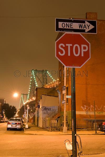 Street Scene at Night in the Williamsburg Neighborhood of Brooklyn, Williamsburg Bridge in the background, New York City, New York State, USA