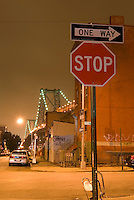 Street Scene at Night in the Williamsburg Neighborhood of Brooklyn, Williamsburg Bridge in the background, New York City, New York State, USA
