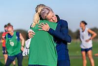 ORLANDO, FL - JANUARY 21: Abby Dahlkemper #7 of the USWNT hugs Megan Rapinoe #15 during a training session at the practice fields on January 21, 2021 in Orlando, Florida.