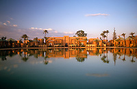 The various buildings of the Amanjena Hotel reflected in the waters of the 'bassin'