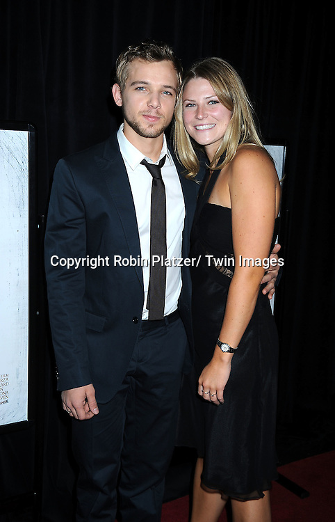 """actor Max Thieriot and girlfriend Alexis Murphy posing for photographers at a special screening of """"My Soul to Take"""" on October 6, 2010 at The AMC Loews Lincoln Square in New York City."""