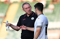 Steve Cooper Head Coach of Swansea City speaks with Liam Walsh of Swansea City during the Pre season friendly match between Plymouth Argyle and Swansea City at Home Park in Plymouth, England, UK. Tuesday 20 July 2021