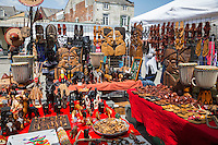 French Quarter, New Orleans, Louisiana.  African Wood Carvings, sandals, and Drums for Sale in the French Market.