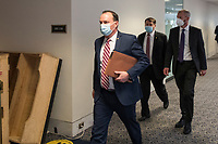 United States Senator Mike Lee (Republican of Utah) and other Senators evacuate to a safe place in the Dirksen Senate Office Building after Electoral votes being counted during a joint session of the United States Congress to certify the results of the 2020 presidential election in the US House of Representatives Chamber in the US Capitol in Washington, DC on Wednesday, January 6, 2021, as interrupted as thousands of pr-Trump protestors stormed the U.S. Capitol and the House chambers.  .<br /> Credit: Rod Lamkey / CNP/AdMedia