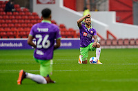 3rd October 2020; City Ground, Nottinghamshire, Midlands, England; English Football League Championship Football, Nottingham Forest versus Bristol City; Nahki Wells of Bristol City takes the knee before the game starts