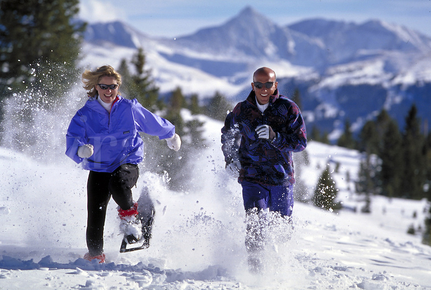 Winter, Vacation, Sports, Active Lifestyle, Adventure, Snowshoeing, Wilderness, Woman, Mountains, Man, Couple, , Racing, Fitness, Training, Exercise, Running, Snowshoes. Asa Armstrong & Bruce Ruff (MR 648, 613). Backcountry Colorado United States Rocky Mo