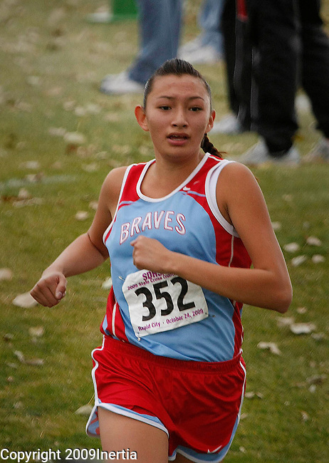 RAPID CITY, SD -- OCTOBER 24, 2009 -- Ashley Iron Moccasin of Cheyenne-Eagle Butte runs  toward the finish in the class A girls event at the 2009 South Dakota State High School Cross Country Meet Saturday in Rapid City. (Photo by Dick Carlson/Inertia)