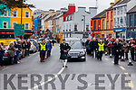 A lone bagpiper leads the funeral cortege of the late Archdeacon Michael Murphy through Kenmare.