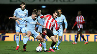 Matheus Jensen of Brentford tackles Kalvin Phillips of Leeds United during Brentford vs Leeds United, Sky Bet EFL Championship Football at Griffin Park on 11th February 2020
