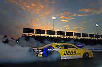 Sept. 28, 2012; Madison, IL, USA: NHRA pro stock driver Jeg Coughlin during qualifying for the Midwest Nationals at Gateway Motorsports Park. Mandatory Credit: Mark J. Rebilas-