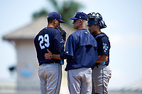 Charlotte Stone Crabs pitching coach Steve Watson (18) talks with his players on the mound during a game against the Bradenton Marauders on April 9, 2017 at LECOM Park in Bradenton, Florida.  Bradenton defeated Charlotte 5-0.  (Mike Janes/Four Seam Images)