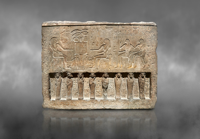 Ancient Egyptian stele of the official Saherhotep & his wife Ipet, limestone, Middle Kingdom, 19th Dynasty, (1759-1700 BC), Old Fund cat 1630. Egyptian Museum, Turin. Grey backgtound.<br /> <br /> 8 mummiform figure in high relief run along the bottom of the stele.