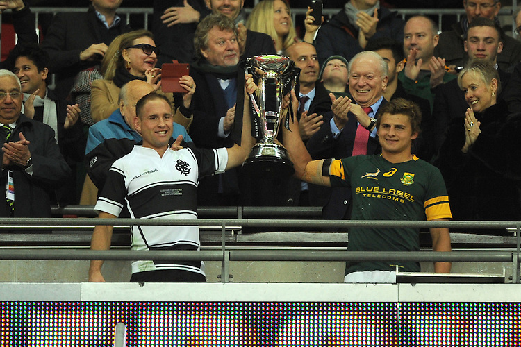 Andy Ellis (Crusaders, Kobelco Steelers & New Zealand) of Barbarians and Patrick Lambie of South Africa lift the Killik Cup after drawing 31-31 at Wembley Stadium on Saturday 5th November 2016 (Photo by Rob Munro)