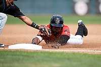 Erie SeaWolves left fielder Christin Stewart (35) slides head first into the tag of third baseman Ivan Castillo during a game against the Akron RubberDucks on August 27, 2017 at UPMC Park in Erie, Pennsylvania.  Akron defeated Erie 6-4.  (Mike Janes/Four Seam Images)