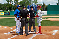 Dunedin Blue Jays manager Cesar Martin (16) and Clearwater Threshers manager Marty Malloy (2) during the lineup exchange with umpires Hardie Acosta (left) and Tanner Dobson (right) before a Florida State League game on April 7, 2019 at Jack Russell Memorial Stadium in Clearwater, Florida.  Dunedin defeated Clearwater 2-1.  (Mike Janes/Four Seam Images)