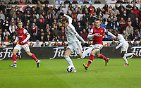 Pictured: Michu of Swansea (C) marked by Laurent Koscielny (R) swings around to take an off target shot.  Saturday 16 March 2013<br /> Re: Barclay's Premier League, Swansea City FC v Arsenal at the Liberty Stadium, south Wales.
