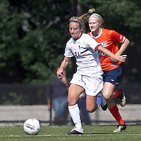 Boston College forward/midfielder Kate McCarthy (21) brings the ball forward as University of Virginia forward Mary Morgan (21) closes. Boston College defeated University of Virginia, 2-0, at the Newton Soccer Field, on September 18, 2011.