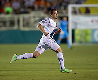Robbie Rogers (14) of the LA Galaxy sprints upfield during a third round match in the US Open Cup at WakeMed Soccer Park in Cary, NC.  The Carolina Railhawks defeated the LA Galaxy, 2-0.