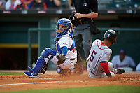Buffalo Bisons catcher Raffy Lopez (43) attempts to tag Neftali Soto (5) slides home during a game against the Syracuse Chiefs on July 3, 2017 at Coca-Cola Field in Buffalo, New York.  Buffalo defeated Syracuse 6-2.  (Mike Janes/Four Seam Images)