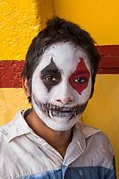 Mexico, Mexico City. Day of the Dead, Dia de los Muertos. Boy with painted face.