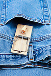 Mouse trap(s) on clothing, shirt or pants, protecting openings from whats within. Shaggy denim pants.