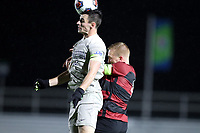 CARY, NC - DECEMBER 13: Dylan Nealis #12 of Georgetown University heads the ball over Derek Waldeck #4 of Stanford University during a game between Stanford and Georgetown at Sahlen's Stadium at WakeMed Soccer Park on December 13, 2019 in Cary, North Carolina.