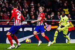 Filipe Luis of Atletico de Madrid (C) in action against Ousmane Dembele of FC Barcelona (R) during the La Liga 2018-19 match between Atletico Madrid and FC Barcelona at Wanda Metropolitano on November 24 2018 in Madrid, Spain. Photo by Diego Souto / Power Sport Images