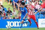 Getafe CF's Gaku Shibasaki (l) and Atletico de Madrid's Lucas Hernandez during friendly match. August 11,2017. (ALTERPHOTOS/Acero)