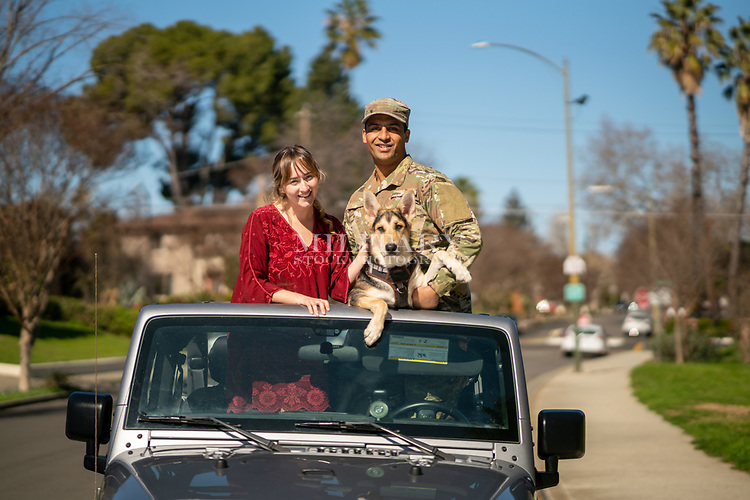 Happy young proud off duty US Army soldier with his wife and Jeep, for sale as stock photography