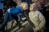 Al Asad Air Base, Iraq - December 19, 2008 -- American Idol contestant and country musician Kellie Pickler grants a Christmas wish for a kiss to United States Marine Sergeant Christopher Lambert at the   2008 USO Holiday Tour stop at Al Asad Air base, Iraq, Friday, December 19, 2008.  Tour host United States Navy Admiral Mike Mullen, chairman of the Joint Chiefs of Staff, along with his wife Deborah, welcomed comedians John Bowman, Kathleen Madigan and Lewis Black; actress Tichina Arnold; American Idol contestant and country musician Kellie Pickler and Grammy award winning musician Kid Rock on the tour bringing music and entertainment to service members and their families stationed overseas. .Credit: Chad J. McNeeley - DoD via CNP