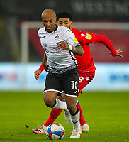 30th December 2020; Liberty Stadium, Swansea, Glamorgan, Wales; English Football League Championship Football, Swansea City versus Reading; Andre Ayew of Swansea City brings the ball forward while under pressure from Josh Laurent of Reading FC
