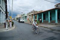 Cyclist on a street in Vinales, Pinar del Rio Province, Cuba.