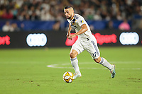CARSON, CA - SEPTEMBER 15: Sebastian Lletget #17 of the Los Angeles Galaxy dribbles the ball during a game between Sporting Kansas City and Los Angeles Galaxy at Dignity Health Sports Complex on September 15, 2019 in Carson, California.