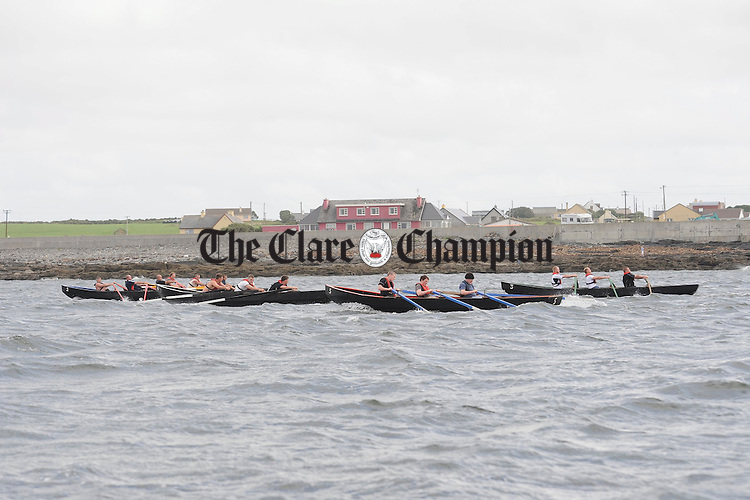 Competing teams battle it out at the Leon Currach Regatta at Seafield, Quilty. Photograph by John Kelly.