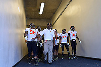 Oklahoma State defensive tackle Ofa Hautau (98) leads the team to the field before an NCAA football game kickoff, Saturday, October 18, 2014 in Fort Worth, Tex. TCU defeated Oklahoma State 42-9. (Mo Khursheed/TFV Media via AP Images)
