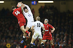 Wingers Jonny May and Alex Cuthbert compete for the high ball.<br /> 2015 RBS 6 Nations<br /> Wales v England<br /> Millennium Stadium <br /> 06.02.15<br /> ©Steve Pope -SPORTINGWALES