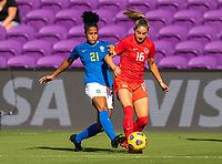 ORLANDO, FL - FEBRUARY 24: Tainara #21 Brazil defends Janine Beckie #16 of Canada during a game between Brazil and Canada at Exploria Stadium on February 24, 2021 in Orlando, Florida.