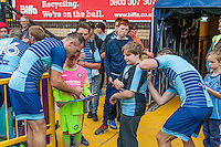 Players sign shirts during the Wycombe Wanderers 2016/17 Team & Individual Squad Photos at Adams Park, High Wycombe, England on 1 August 2016. Photo by Jeremy Nako.